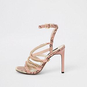 Roze sandalen met kettingbandjes en hak