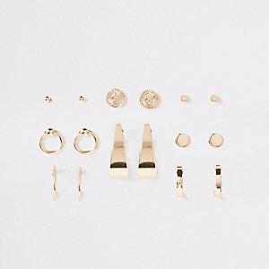 Lot de clous d'oreilles motif pièce et anneau dorés