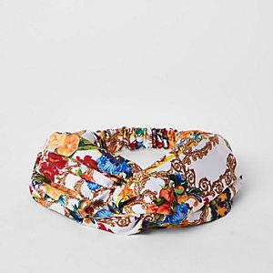 Witte gedraaide hoofdband met barokprint