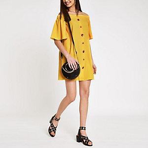 Robe Bardot trapèze jaune boutonnée sur le devant