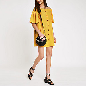 Gele swingjurk in bardotstijl met knopen voor