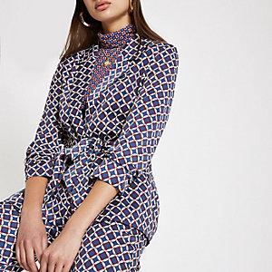 Blauwe blazer met geometrische print en ceintuur
