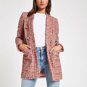 Roze bouclé jasje met ruit