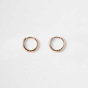 Gold tone small hoop earrings