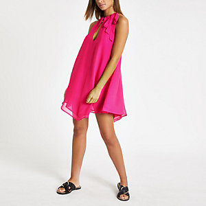 Bright pink halter neck beach dress