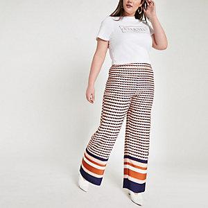 Plus – Pantalon large à imprimé géométrique rose