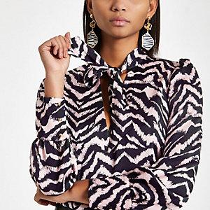 Pink zebra print tie neck blouse