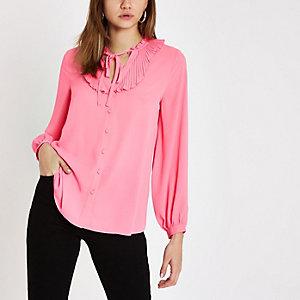 Roze blouse met ruches en strikkraag
