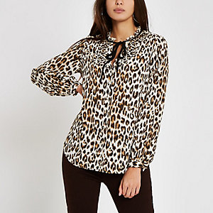 Brown leopard print tie neck blouse