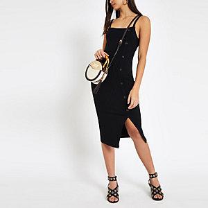 Zwarte geribbelde asymmetrische midi-jurk met knopen opzij