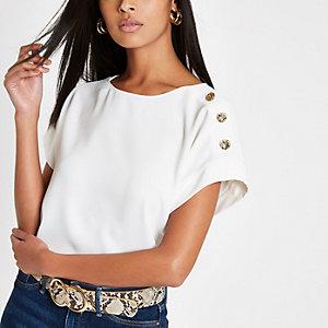 Wit T-shirt met sierknopen