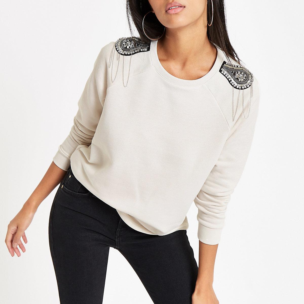 Cream embellished shoulder patch sweater