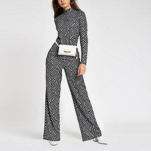 Zwarte jersey broek met geometrische print en wijde pijpen