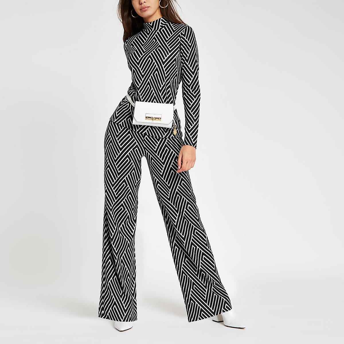 Black geo print wide leg jersey trousers