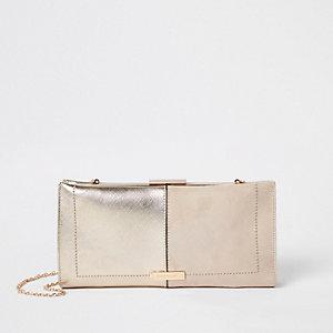 Beige metallic clip top clutch bag