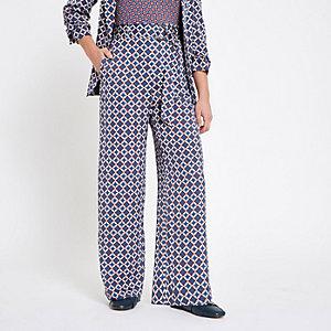 RI Petite - Blauwe broek met wijde pijpen en geometrische print
