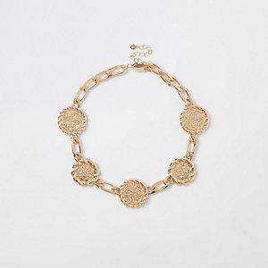 Goudkleurige ketting met medaillon
