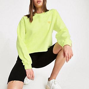 Neongeel sweatshirt met geborduurde wesp