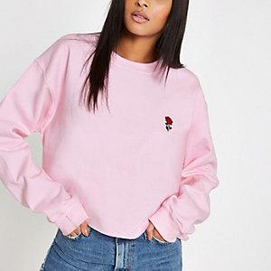 Pink rose embroidered raw hem sweatshirt