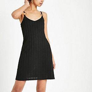 Zwarte swing-jurk van jerseystof met structuur
