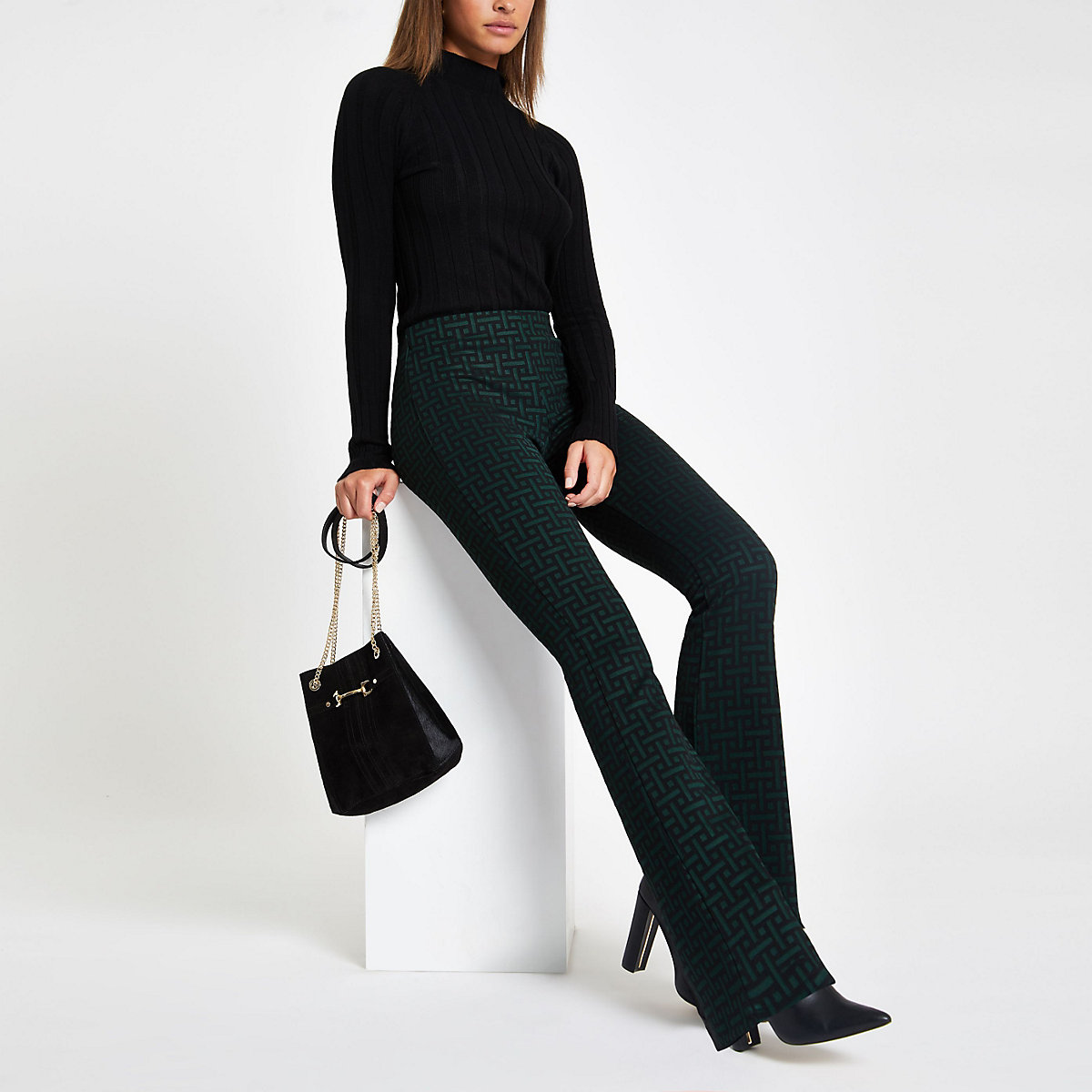 Green geo jersey flare pants