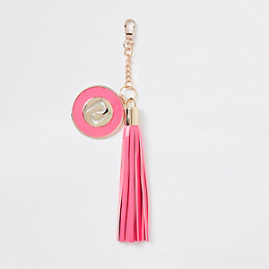 Roze sleutelhanger met kwastje en RI-logo