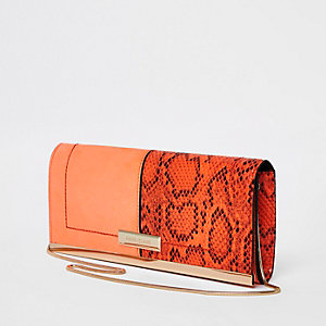Pochette avec empiècement serpent orange