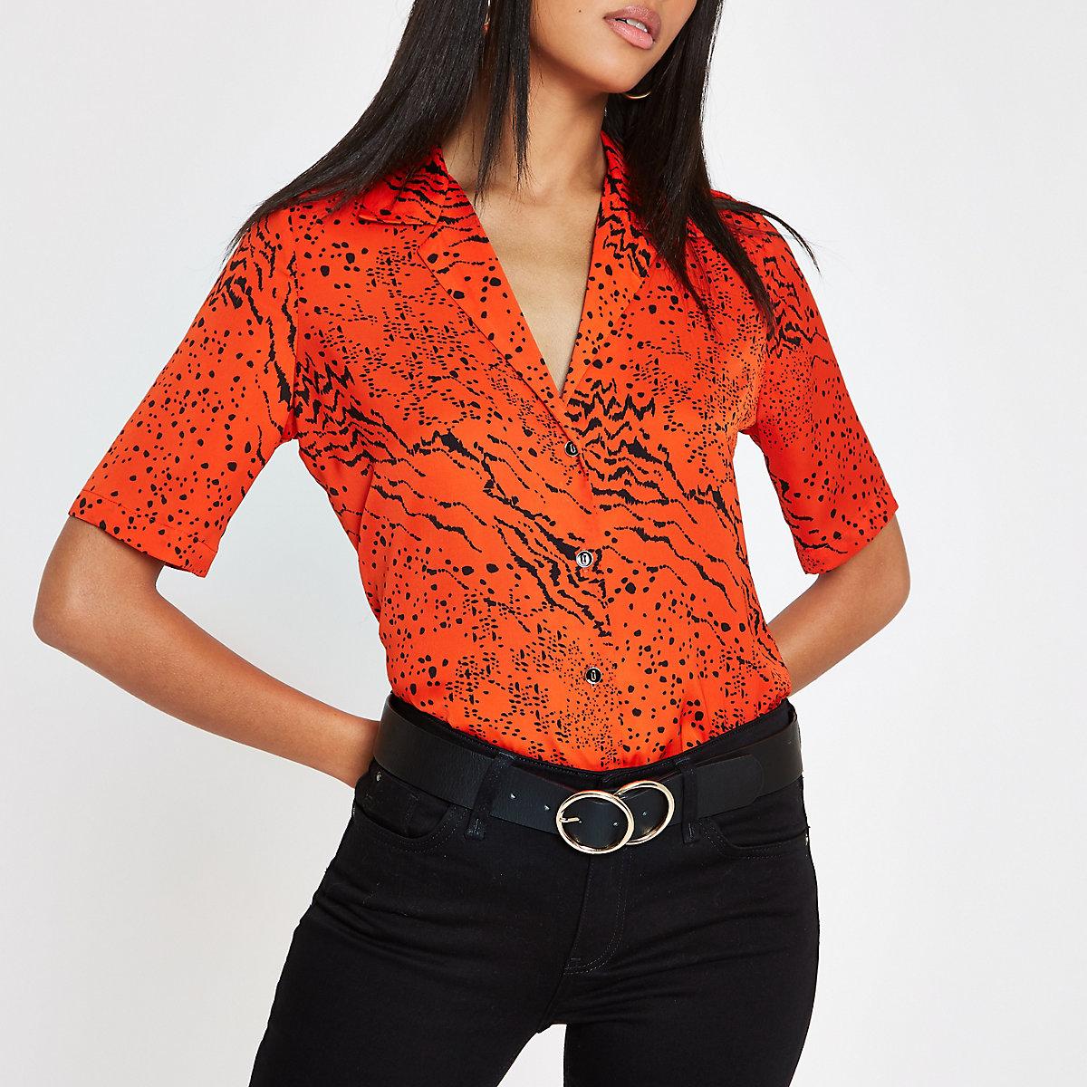 Red animal print short sleeve shirt