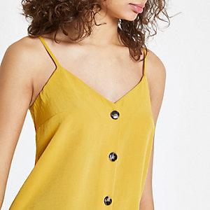 Caraco jaune boutonné sur le devant
