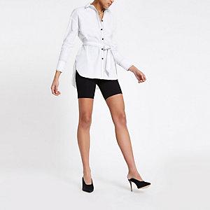 Wit overhemd met strikceintuur en lange mouwen