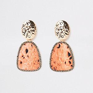 Goudkleurige met oranje oorhangers met slangenprint