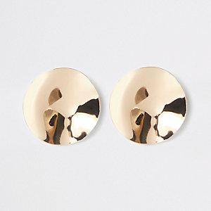 Goudkleurige oorknopjes met geslagen schijf