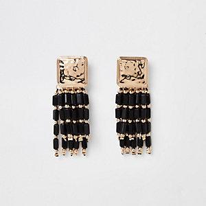 Pendants d'oreilles noirs avec perles