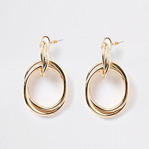 Boucles d'oreilles dorées torsadées motif heurtoir