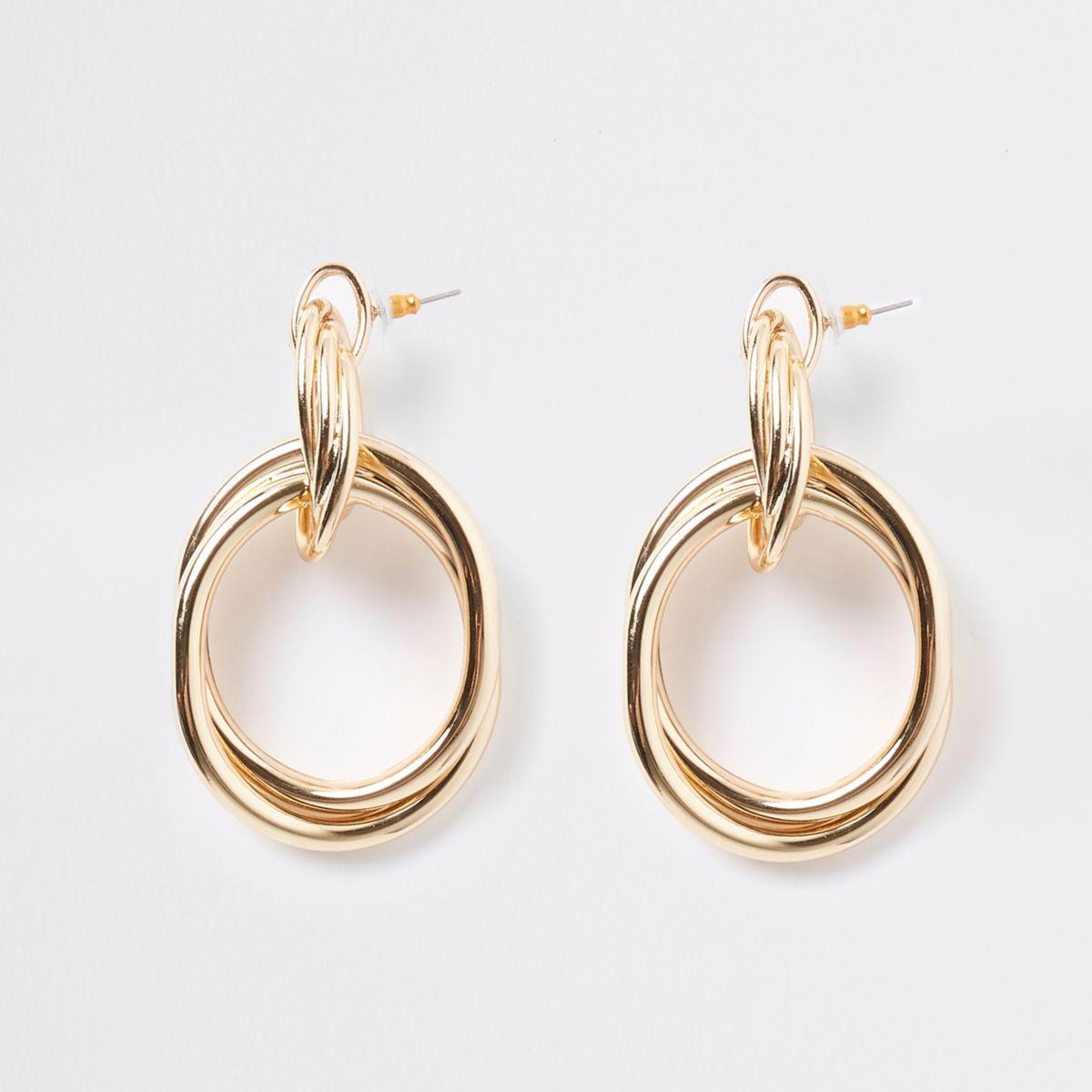 Gold color twist doorknocker earrings