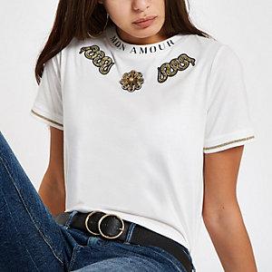Wit verfraaid T-shirt met slangenprint