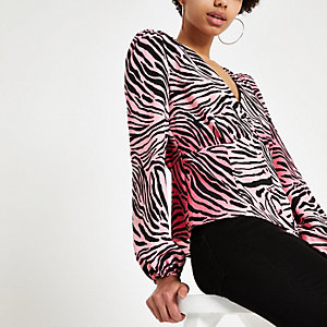 Pink zebra print long sleeve tea top