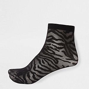 Zwarte doorschijnende sokken met zebraprint