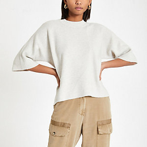 Crème gebreid T-shirt met uitlopende mouwen