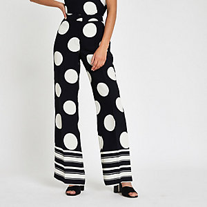 Navy spot print wide leg trousers