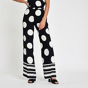 Navy spot print wide leg trousers