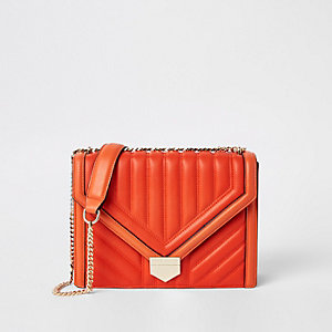 Orange quilted cross body bag