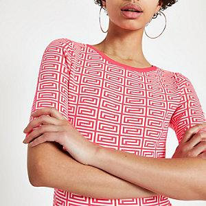 T-shirt en maille à imprimé géométrique rose fluo