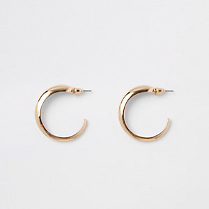Gold tone mini hoop earrings