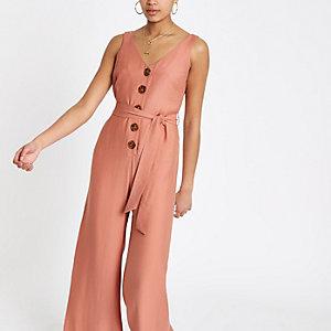 Roze jumpsuit met strikceintuur en wijde pijpen