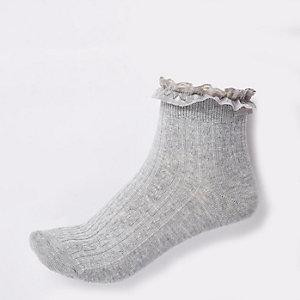 Chaussettes en maille torsadée gris clair à volants