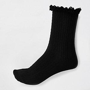 Zwarte sokken met kabelmotief en ruches