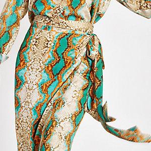 Jupe mi-longue portefeuille imprimé serpent turquoise