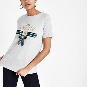 T-shirt gris avec imprimé à paillettes et nœud