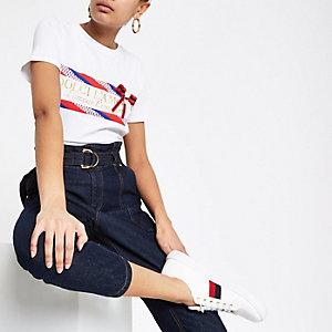 T-shirt blanc avec imprimé à paillettes et nœud